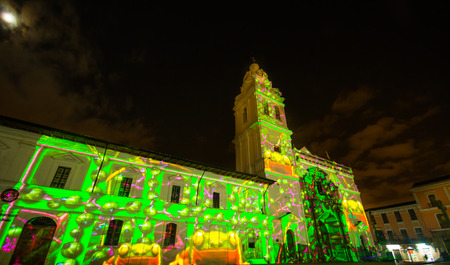 Quito, Pichincha Ecuador - August 9 2017: Close up of spectacle of lights projected on the facade of Church of Santo Domingo, of green leafs representing nature, during the Quito light festival