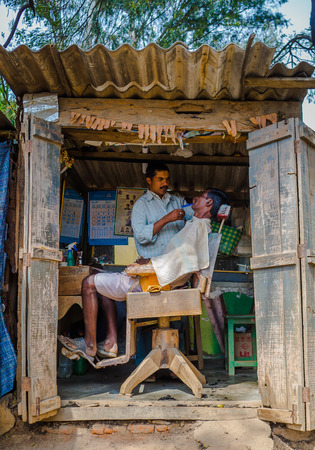 KHAJURAHO, INDIA - DEC 21, 2014: Unidentified people in a professional hairdresser in street salon. Khajuraho is small town with Khajuraho Group of Monuments located in the Indian state of Madhya Pradesh
