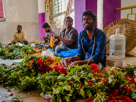 BANGALORE, INDIA - June 06 2017: Flower sellers at KR Market in Bangalore. in Bangalore, India