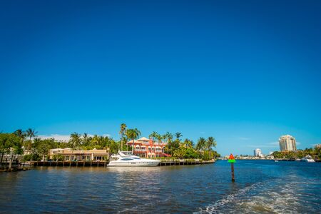 FORT LAUDERDALE, USA - JULY 11, 2017: Beautiful view of new river with riverwalk promenade, with condominium buildings and yachts parked in the river, in Fort Lauderdale, Florida