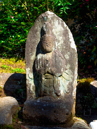 Nara, Japan - July 26, 2017: Close up of japanesse sculpture in a rock in the garden at Todai Ji Temple, in Tokyo