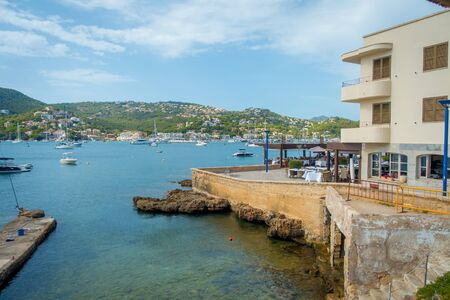 PORT D ANDRATX, SPAIN - AUGUST 18 2017: Andratx port marina in Mallorca balearic islands, with yatchs in the water and some buildings in the horizont, Spain