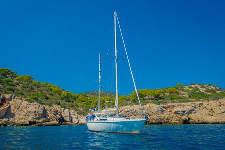 SANT ELM, MAJORCA, SPAIN - AUGUST 18 2017: Nice boat in Sant Elm, in a beautiful blue water and sky in Majorca, Spain Stok Fotoğraf - 85594786