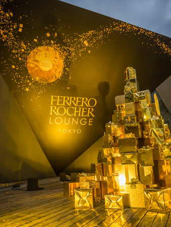 Tokyo, Japan - July 26, 2017: Close up of a beautiful tower of golden presents gifs, about ferrero rocher chocolate convention in the city of Tokyo, by Ferrero Rocher campaigns in Tokyo