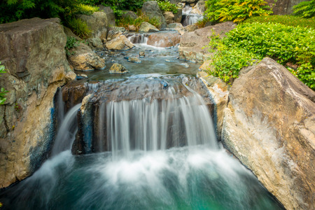 Beautiful riverwith a slow shutter photography water in a Japanesse garden at asakusa temple Tokyo, Japan