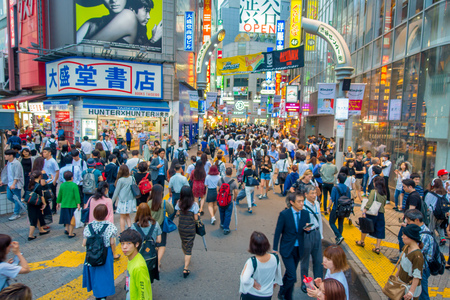 TOKYO, JAPAN JUNE 28 - 2017: Crowd of people in Shopping street near Shibuya, is one of Tokyos most colorful and busy districts, packed with shopping, dining and nightclubs Editorial