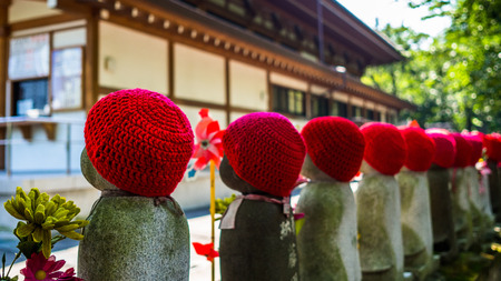 TOKYO, JAPAN - AUGUST 5 2017: Jizo Boddhisattvas at Zojo Buddhist Temple at Tokyo, Japan. Jizo Bodhisattva is the patron saint of thechildrens soul according to the Japanese mythology Editorial
