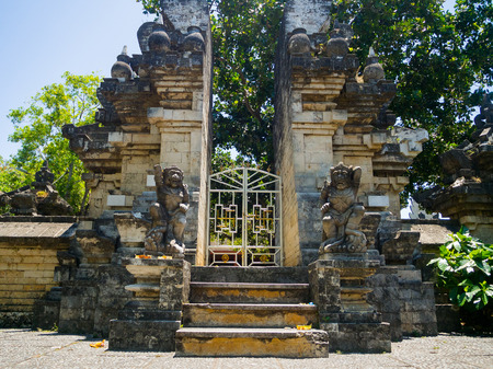 BALI, INDONESIA - MARCH 11, 2017: Entrance of an Indu temple in Ubud, in the island of Bali, located in Indonesia
