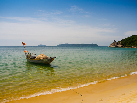 Beautiful view of a boat in the water in a sunny day, in Vietnam. Hoian is recognized as a World Heritage Site by UNESCO