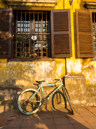 Hoian, Vietnam - August 20, 2017: Close up of a bike parked at backyard in the patio, in a house in Hoi An ancient town, in Vietnam