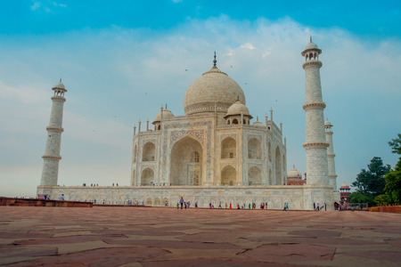 Agra, India - September 20, 2017: Beautiful view of the Taj Mahal, in a gorgeous blue sky, with an ivory-white marble mausoleum on the south bank of the Yamuna riverin the city of Agra, in India Editorial