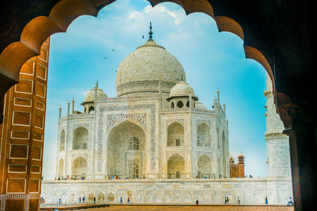 Agra, India - September 20, 2017: Amazing view of the Taj Mahal, in a gorgeous blue sky, with an ivory-white marble mausoleum on the south bank of the Yamuna riverin the city of Agra, in India Editorial