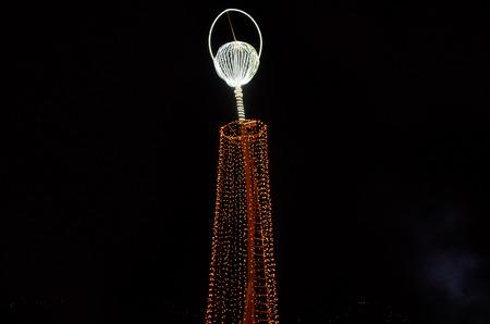 QUITO, ECUADOR - JANUARY 10, 2017: Bright orange lights located in La Virgen de El Panecillo in the city center photographed at night. Quito is an UNESCO World Cultural Heritage Site
