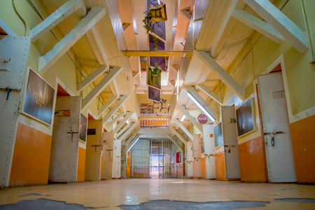 QUITO, ECUADOR - NOVEMBER 23, 2016: Indoor view of old deserted rugged building, cells of prisoners in the old prison Penal Garcia Moreno in the city of Quito
