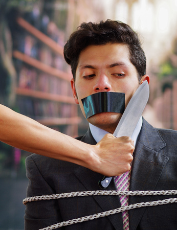 criminal: Businessman trapped in a chair with rope, with a black tape in his mouth, afraid of a hand that is holding a knife near of his neack, in a blurred background