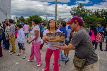 fema: Quito, Ecuador - April,17, 2016: Crowd of people of Quito providing disaster relief food, clothes, medicine and water for earthquake survivors in the coast, located in the Carolina park