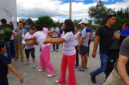 fema: Quito, Ecuador - April,17, 2016: Unidentified citizens of Quito providing disaster relief food, clothes, medicine and water for earthquake survivors in the coast. Gathered at la Caolina Park Editorial