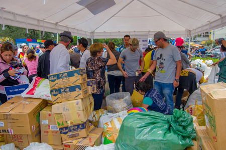 fema: Quito, Ecuador - April,17, 2016: Unidentified people in Quito providing disaster relief food, clothes, medicine and water for earthquake survivors in the coast Editorial