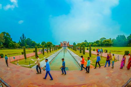 Agra, India - September 20, 2017: Unidentified people walking in garden near Darwaza-i-Rauza in Chowk-i Jilo Khana at Taj Mahal complex in Agra,India. The gate is main entrance to the tomb, fish eye effect.