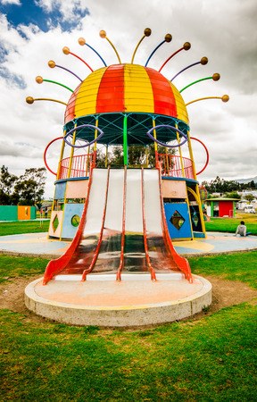 CAYAMBE, ECUADOR - SEPTEMBER 05, 2017: Beautiful colorful metallic structure of representation of diablada festival, located in the midle of a park in the city of Cayambe, Ecuador