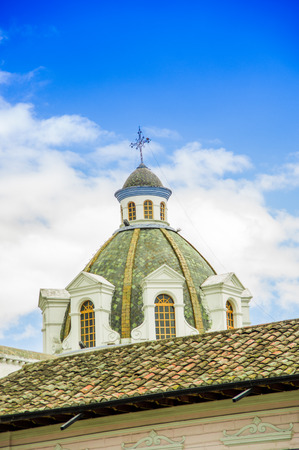 CAYAMBE, ECUADOR - SEPTEMBER 05, 2017: Beautiful view of ancient construction dome in a gorgeous blue sky in Cayambe, Ecuador
