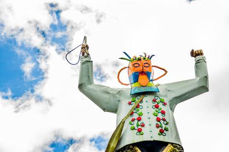 CAYAMBE, ECUADOR - SEPTEMBER 05, 2017: Metallic man monument over a metallic planet, located in the city of Cayambe, Ecuador