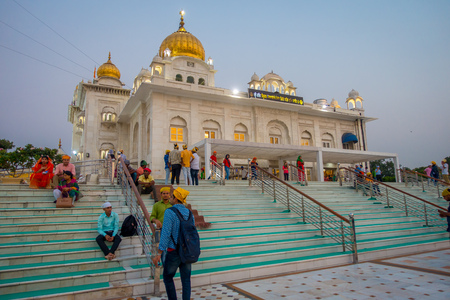 DELHI, INDIA - SEPTEMBER 19, 2017: people walking upstairs and dowstairs in the Famous Sikh gurdwara Golden Temple Harmandir Sahib in India Editorial