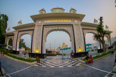 DELHI, INDIA - SEPTEMBER 19, 2017: Big white gate to the enter of Gurudwara Bangla Sahib Sikh Temple, located in New Delhi, India, fish eye effect