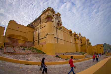 Amber, India - September 19, 2017: Unidentified people walking in a stoned path at outdoors in the city in Amber Fort in Jaipur, Rajasthan, India Editorial