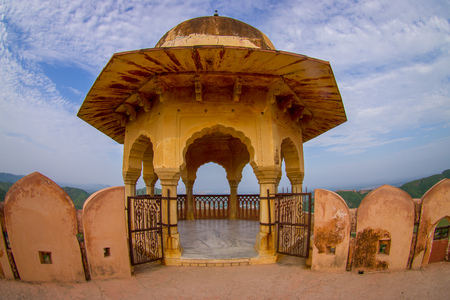 dome of hindu temple: Amer, India - September 19, 2017: Beautiful view of a balcony with a yellow dome in Amber Fort palace, located in Amer, Rajasthan, India