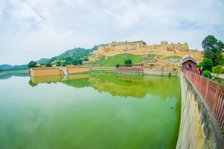 Amer, India - September 19, 2017: Unidentified people walking and enjoying the view of Maota Lake in Amber Fort in Jaipur, Rajasthan, India, fish eye effect