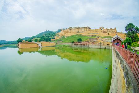 Amer, India - September 19, 2017: Unidentified people walking and enjoying the view of Maota Lake in Amber Fort in Jaipur, Rajasthan, India, fish eye effect