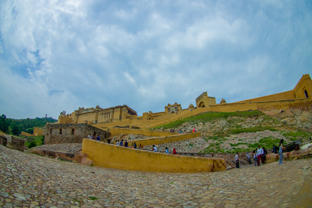 Amer, India - September 19, 2017: Unidentified people walking upstairs and dowstairs in beautiful Amber Fort near Jaipur, India, fish eye effect