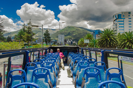 QUITO, ECUADOR - SEPTEMBER 10, 2017: Unidentifed people enjoying the beautiful view from touristic bus around different touristic places in the city of Quito in Quito, Ecuador Editorial