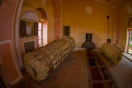 Indoor viw of a stoned structure with a stoned machine inside of a bulding in Ambert Fort palace, located in Amer, Rajasthan, India Stock Photo