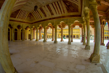 Collumned hall in Sattais Katcheri in Amber Fort near Jaipur, Rajasthan, India. Amber Fort is the main tourist attraction in the Jaipur area, fish eye effect