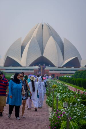 Delhi, India - September 27, 2017: Unidentified people enjoying the beautiful Lotus Temple, located in New Delhi, India, is a Bahai House of Worship Editorial