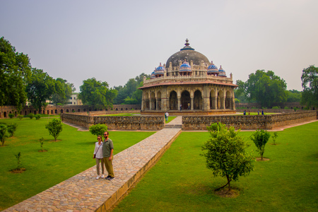 DELHI, INDIA - SEPTEMBER 19, 2017: Unidentified people posing for a picture in front of a beautiful tomb building of Isa Khan Niazi in humayum tomb complex, New Delhi, India, fish eye effect Editorial
