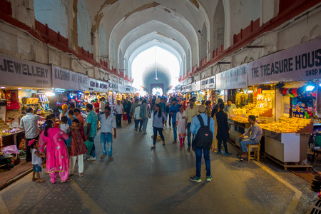 DELHI, INDIA - SEPTEMBER 25 2017: Crowd of people walking and buying inside the Bazaar in the Red Fort in Delhi, India. Meena Bazaar, built by Mukarmat Khan 300 years ago, was the first covered bazaar in India