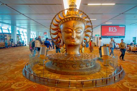 DELHI, INDIA - SEPTEMBER 19, 2017: The big golden statue in international Airport of Delhi. Indira Gandhi International Airport is the 32th busiest in the world
