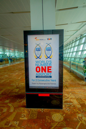 DELHI, INDIA - SEPTEMBER 19, 2017: Informative sign in an automatic screen of world s number one airport two consecutive years in 2014 and 2015 in the International Airport of Delhi, Indira Gandhi International Airport Sajtókép