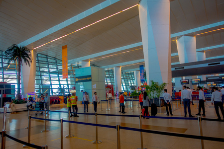 DELHI, INDIA - SEPTEMBER 19, 2017: Unidentified people walking in the International Airport of Delhi, Indira Gandhi International Airport is the 32th busiest in the world