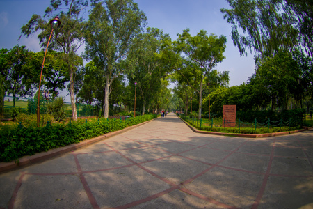 DELHI, INDIA - SEPTEMBER 25 2017: Gorgeous view of the park where is located the Rajghat, New Delhi as memorial at Mahatma Gandhis body cremation place, in Delhi India, eye fish effect Editorial