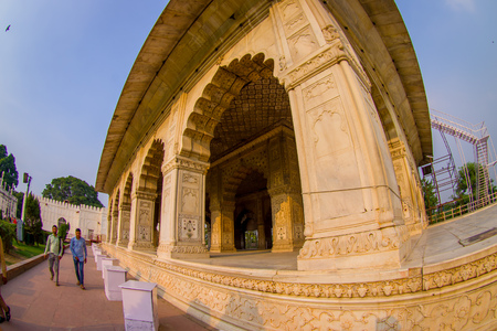 mughal empire: DELHI, INDIA - SEPTEMBER 25 2017: Unidentified people walking at outdoors of Inlaid marble, columns and arches, Hall of Private Audience or Diwan I Khas at the Lal Qila or Red Fort in Delhi, India, fish eye effect