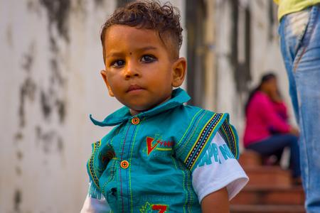 Delhi, India - September 20, 2017: Portrait of a beautiful boy looking at camera in Delhi India