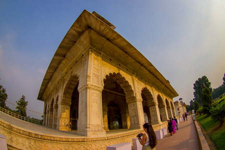 mughal empire: DELHI, INDIA - SEPTEMBER 25 2017: Unidentified people walking around Inlaid marble, columns and arches, Hall of Private Audience or Diwan I Khas at the Lal Qila or Red Fort in Delhi, India, fish eye effect Editorial