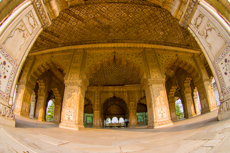 DELHI, INDIA - SEPTEMBER 25 2017: Indoord view of Inlaid marble, columns and arches, Hall of Private Audience or Diwan I Khas at the Lal Qila or Red Fort in Delhi, India, fish eye effect