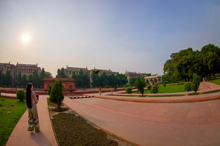 DELHI, INDIA - SEPTEMBER 25 2017: Unidentified people walking in a stoned path at outdoor of the Sawan or Bhadon Pavilion in Hayat Baksh Bagh of Red Fort at Delhi. Fish eye effect