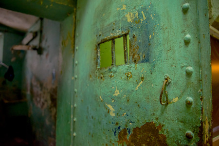 QUITO, ECUADOR - NOVEMBER 23, 2016: Close up of old rusted metallic door, in the old prison Penal Garcia Moreno in the city of Quito.