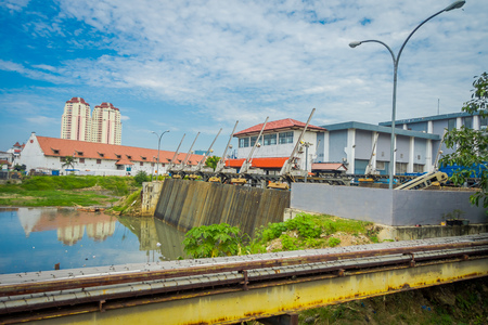 Smaller water hydropower plant located in city neighborhood in Jakarta Indonesia Stock Photo